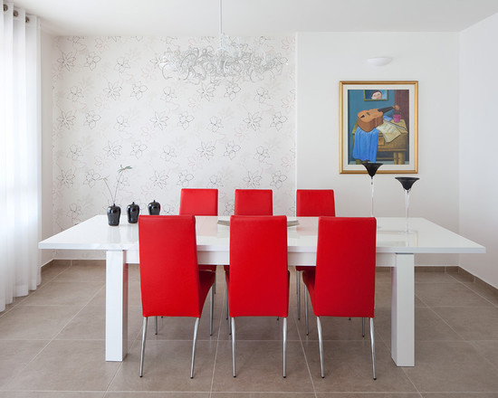 modern dining room white dining table paired with a monochromatic red